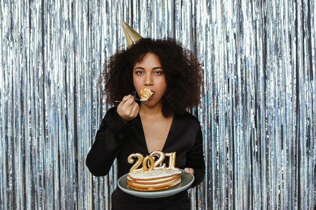 Woman eating cake 2021