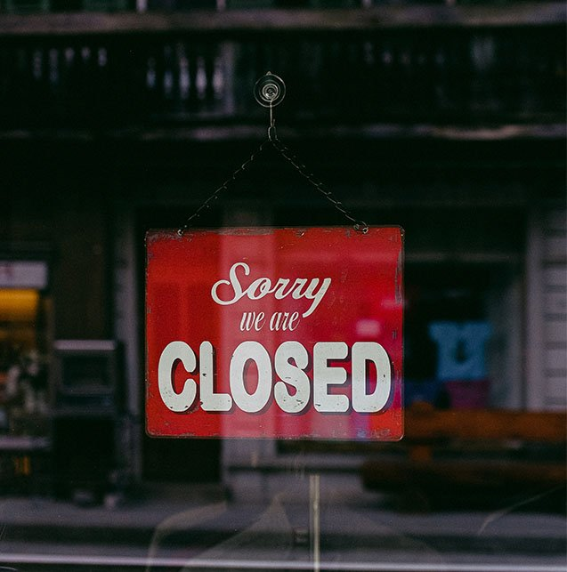Shop showing a Sorry We Are Closed Sign